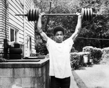 Lifting weights at home. (The Pittsburgh Press)