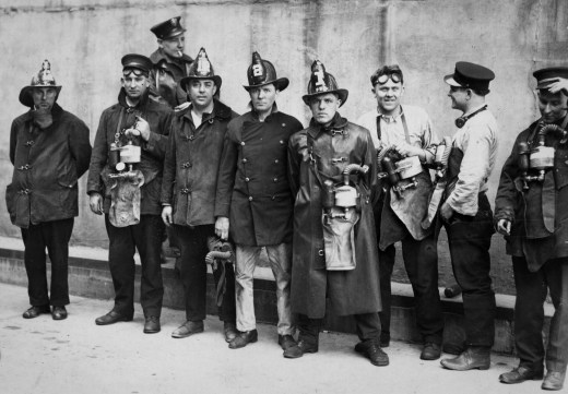 Firefighters who'd conducted rescue efforts pose for a picture. (The Pittsburgh Press)