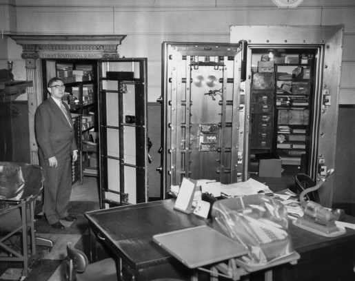 Cashier Ernest L. Clinger and the safe in which he and several others were trapped. (Post-Gazette)