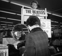 A boy tries on a Beatles wig on Feb. 14, 1964. (Post-Gazette)