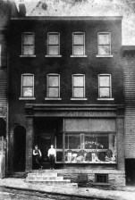 Joseph Pampuch, left, in the doorway of his Brerton Avenue shop in Polish Hill circa 1918. With him is an unidentified employee.