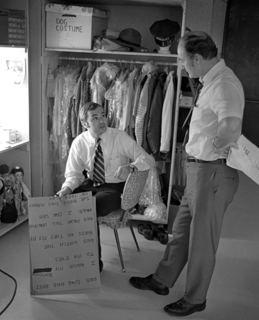 Props manager David Newell (left) and set designer Jack Guest discuss production details.