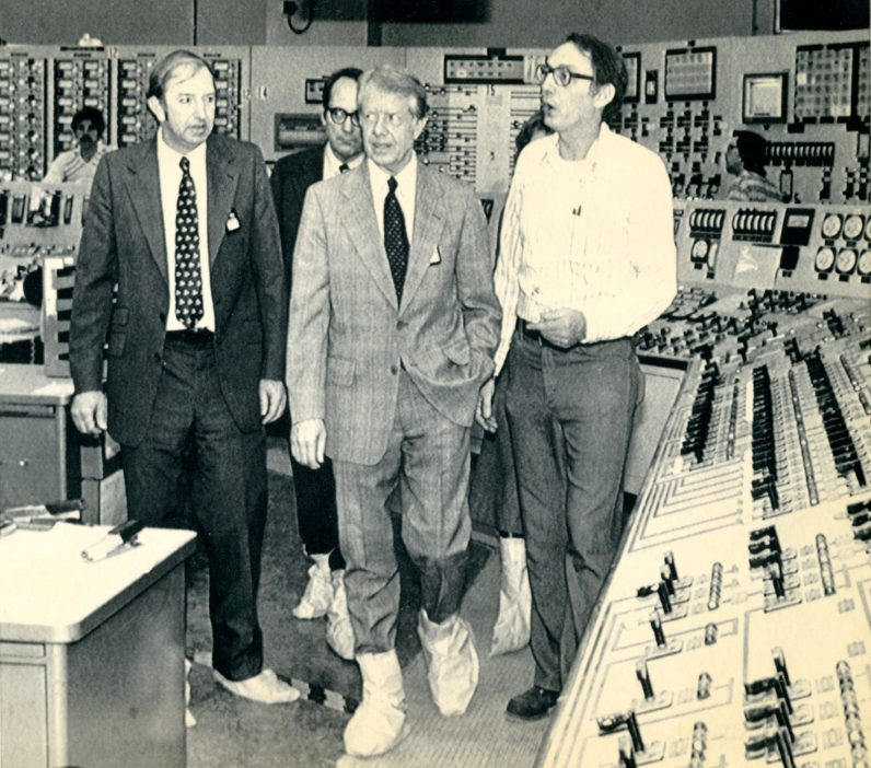 President Jimmy Carter (center, front) tours the control room of the Three Mile Island plant April 1, 1979, one week after the accident occurred. Pennsylvania Governor Dick Thornburgh (center, rear) and Dr. Harold Denton, Director of the U.S. Nuclear Agency, joined Carter and several unidentified plant employees. (Associated Press)