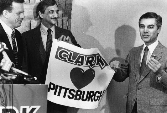 (From left to right) Erkki Railo, President and CEO of Leaf Inc.; Sam Papa, President of Local #12 Bakery and Confectionary Workers; and Pittsburgh Mayor Richard Caliguiri hold a press conference to announce that the D.L. Clark candy factory would remain in Pittsburgh through 1991. Picture published Feb. 13, 1986. (Pittsburgh Post-Gazette)