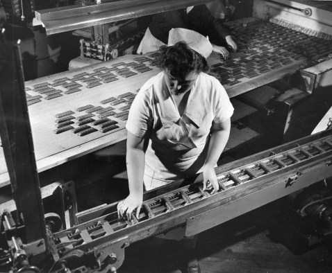 These candy bars are finished and ready for wrapping. Most of them were headed abroad, as 80 percent of the plant's production went to military personnel during World War II and continued to feed service people overseas. Picture taken March 21, 1948. (Pittsburgh Press)