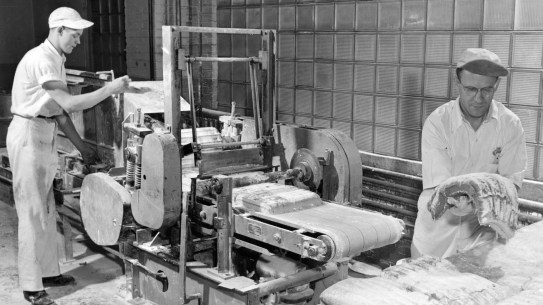 This 1000 lb. batch of gum is rolled into slabs and covered in a layer of sugar powder. Another series of rollers thins the gum into large sheets that are the thicknewss of a single stick. The firm produced about 45,000 lb. of gum a day at this point. Picture taken March 21, 1948. (Pittsburgh Press)