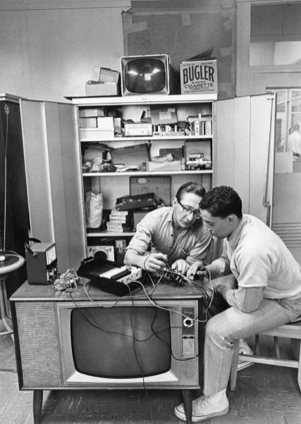 Inmate Sheldon Dorian, right, shows Garfield Gordin how to check volume controls on a TV set. Dorian spent $800 he saved from working in prison workshops to purchase equipment for the program's electronics class. Photo published Nov. 23, 1969. (Pittsburgh Press)