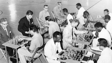 "Members of Pittsburgh Chess Club battle Walled Knights, Western Penitentiary's chess team. ""Chess makes [inmates'] reentry into society much easier. All the clubs start bidding for them and they are invited into players' homes as players and friends,"" Warden Joseph R. Brierly said of the league, which he organized. Photo published Aug. 3, 1969. (Pittsburgh Press)"