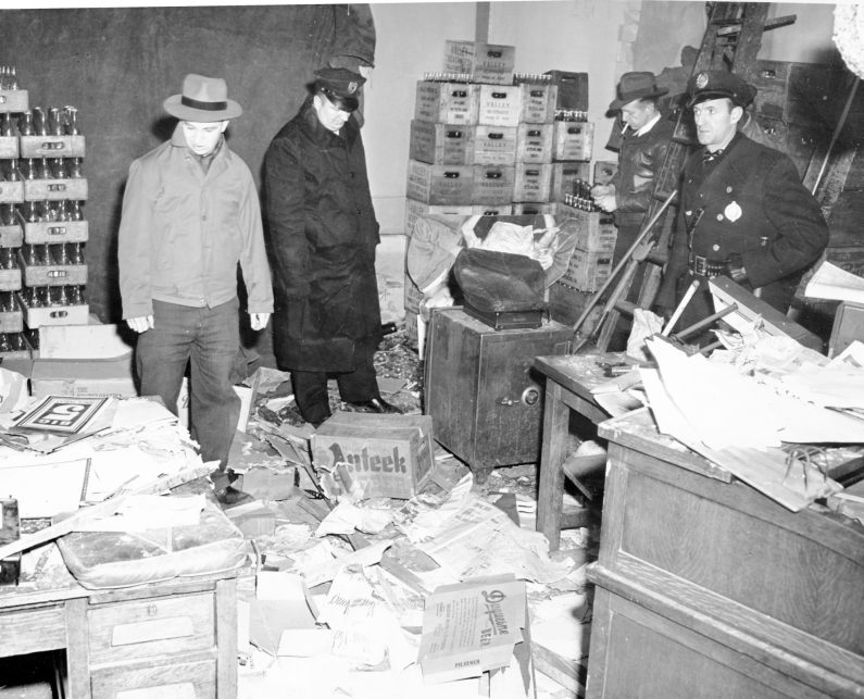 Police investigate a beer distributor ransacked and robbed. Photo published Jan. 31, 1947. (Pittsburgh Press)