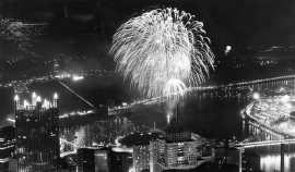 Fireworks explode above the city, as seen from the USX Building in downtown. Photo published July 6, 1987. (Pittsburgh Press)