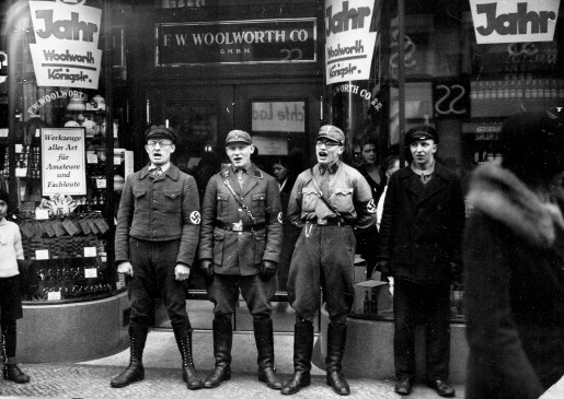 Four Nazi soldiers sing in front of the Berlin branch of the Woolworth Co. store during the movement to boycott Jewish presence in Germany in March 1933. (Associated Press)