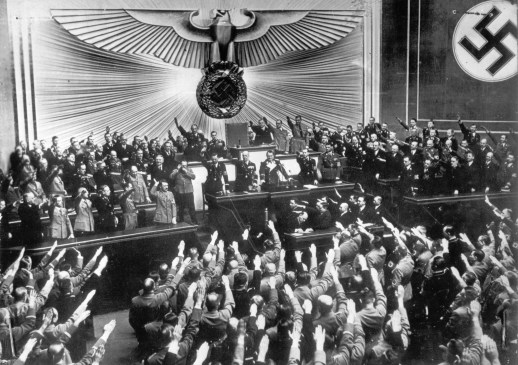 After announcing the annexation of Austria before the Reichstag in Berlin, Hitler receives a standing ovation from the representatives of the German parliament in Berlin, March 13, 1938. (Associated Press)