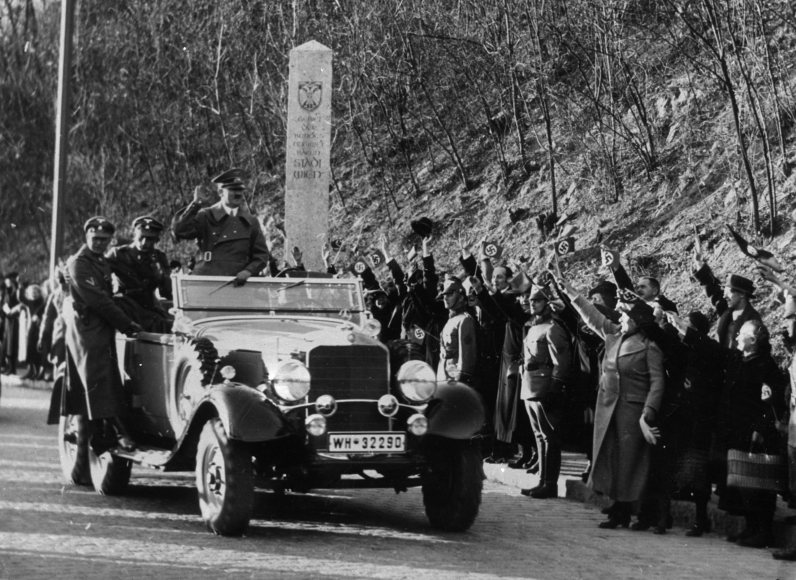 Adolf Hitler enters Vienna, March 14th 1938, passing the city boundary. (Associated Press)