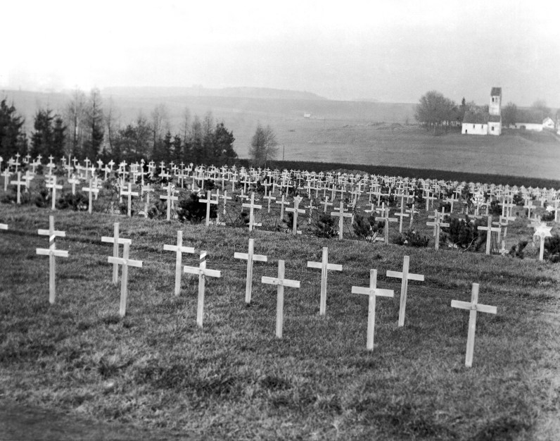 Rows of white wooden crosses mark the graves of some of the victims of the former concentration camp just outside Dachau on Dec. 23, 1948. (AP Photo)