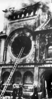 In this November 1938 file photo, firefighters walk next to the Fasanenstrasse synagogue, Berlin's biggest house of Jewish worship, after Nazis set fire to it on Nov. 9, 1938. (Associated Press)