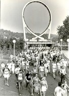 Under the shadow of the Laser Loop, enthusiastic coaster riders enter Kennywood Park for a morning of rolling revelry on June 29, 1980. (Robert Pavuchak/Post-Gazette)