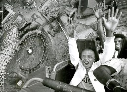 Kamau Thomas, 9, checks out the first day of Kennywood Park from an inverted and somewhat elevated angle-via the park's Laser Loop ride on April 19, 1987. The Arlington boy was accompanied by his uncle Calvin Phipps of Knoxville as they took to the air with other guests. (Vince Musi/Pittsburgh Press)