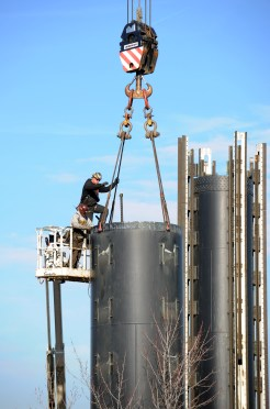 Construction workers dismantle the Pitt Fall at Kennywood Park on December 13, 2011. (Lake Fong/Post-Gazette)