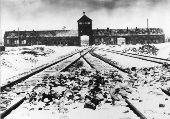 Entry to the Auschwitz-Birkenau concentration camp with snow covered railtracks leading to the camp in February 1945 (Associated Press)