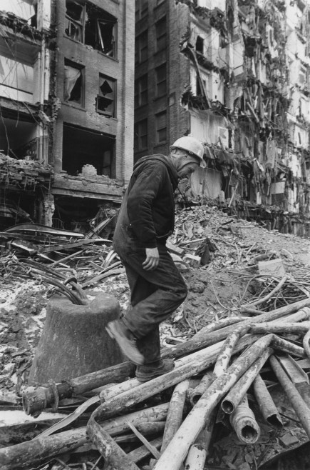 John Kesler walks through the rubble of the Empire Building, which neighbored the Jenkins Arcade, in 1984. (Andy Sternes/Post-Gazette)