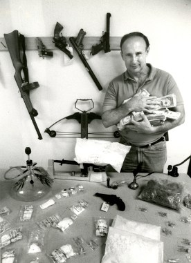 Lt. Bob Kanith of Allegheny County Police, surrounded by a small portion of the county's confiscated drugs in 1989. (John Kaplan/The Pittsburgh Press)