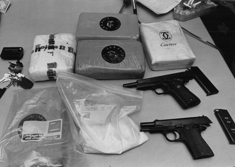 Loot from a Wilkinsburg drug raid: five kilos of cocaine and two handguns. (Bob Donaldson, Pittsburgh Post-Gazette, 2/6/92)