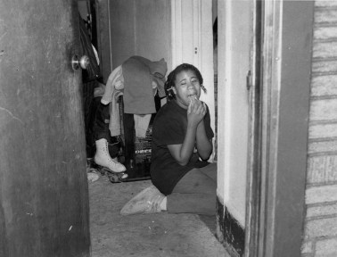 From 1992: a 13-year-old girl cries as police raid her home, searching for cocaine. (John Heller/The Pittsburgh Press)