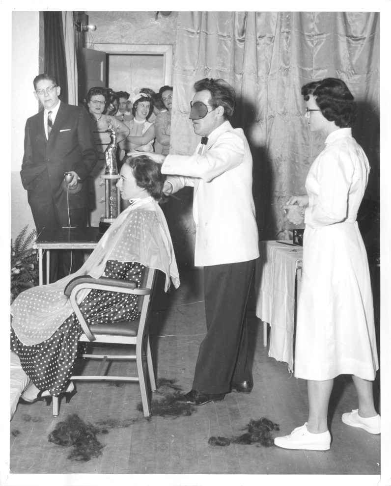 Franco Insana gives a haircut with his eyes covered. (Courtesy of the Detre Library & Archives at the Heinz History Center)