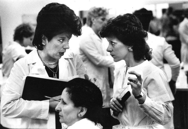 An aspiring graduate consults her exam proctor, 1985.