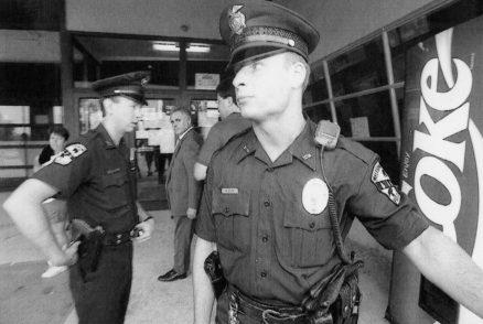 Police stand guard at Club 51. (John Heller/Post-Gazette)