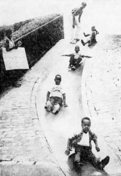 Children from the North Side enjoy the Frick Park slide after they dropped their protest signs in favor of fun in this 1969 photo.