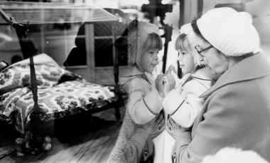 Alicia Carothers of Gisbonia, 4, and her grandmother Else Zupko of the North Side, get a close-up view of a Christmas display window at Kauffman's, Dec. 13, 1980. (Ross A. Catanza/Pittsburgh Press)