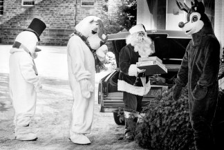 Christmas characters deliver gifts at St. Anthony's School for Exceptional Children in a Cadillac sleigh, Dec. 24, 1980. (Post-Gazette)