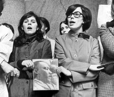 Linda Hall, left, and Jane Smathers join hundreds of other local college students after a memorial march for the Rev. Martin Luther King Jr., April 6, 1968, in City Hall, Downtown. (Anthony Kaminski/Pittsburgh Press)