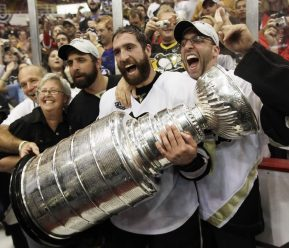Forward Maxime Talbot celebrates with family after the Penguins beat in Game 7 of the Stanley Cup, June 12, 2009.. (AP Photo/Paul Sancya)