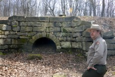 Ranger Doug Bosley stands near a restored colvert along part of the 120 ft. wide trail that had two sets of tracks for the Allegheny Portage Railroad. It led to the Nations' First Railroad Tunnel, four miles from Johnstown. The Allegheny Portage Railroad was the first railroad to cross the Allegheny Mountains. The Portage Railroad was 36 miles long. (Darrell Sapp/Post-Gazette)