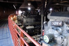 The restored roundhouse at Steamtown is both a maintenance shop and an exhibit hall with raised platforms so visitors can view the cars and engines up close. (Laura Legere/Post-Gazette)