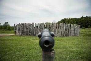 A representation of Fort Necessity and a model canon stand at the Fort Necessity National Battlefield in Farmington on June 22, 2016. (Haley Nelson/Post-Gazette)