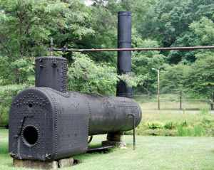 A boiler is one of the vestiges of steam power on the oil field. The boiler was placed as far way as possible from where drillers hoped to hit gas.