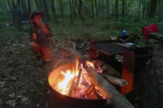 8-year-old Jesse Batz roasts a marshmallow at a campsite along the North Country National Scenic Trail in Butler County. The trail stretches from New York's Vermont border all the way to North Dakota. (Bob Batz Jr./Post-Gazette)