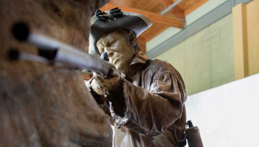 A model of a soldier crouches in the Fort Necessity National Battlefield Visitor Center in Farmington on June 22, 2016. (Haley Nelson/Post-Gazette)