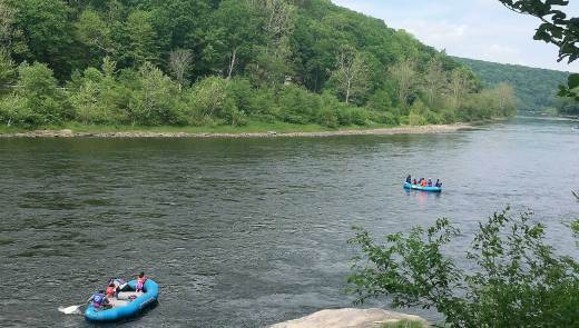 Rafters float down the Delaware River in Westfall Township, Pa. on May 29, 2016.