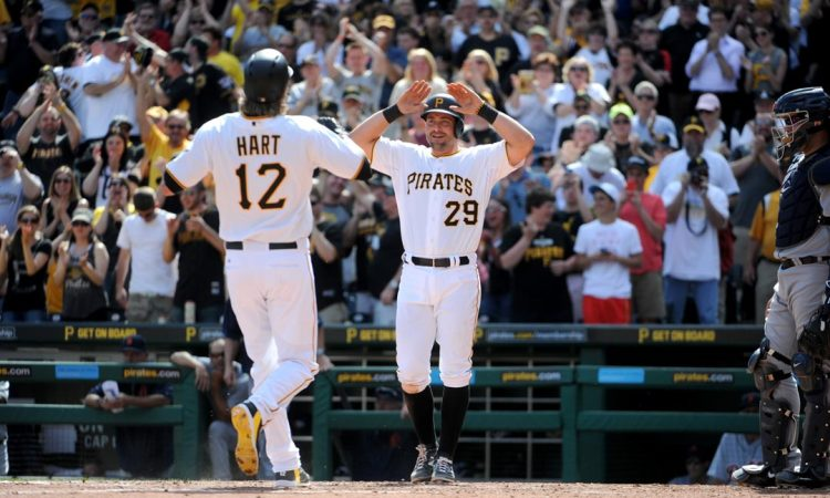 Francisco Cervelli (29) celebrates with Corey Hart (12) after Hart's  two-run homer.  (Andrew Rush/Post-Gazette)