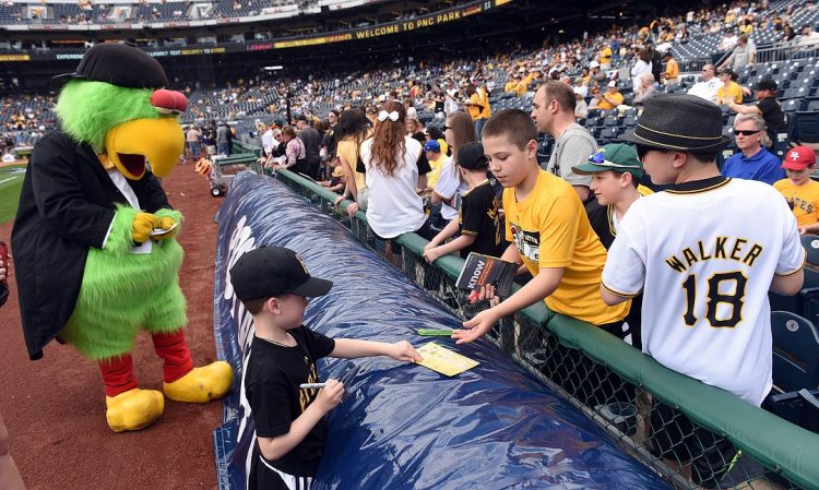 """Jackson Geiger, 6, of Mars, joined the Pirate Parrot as a """"side kick"""" and signed autographs. (Steve Mellon/Post-Gazette)"""