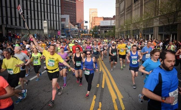 Runners clog Liberty Avenue near Grant Street.  (Steve Mellon/Post-Gazette)