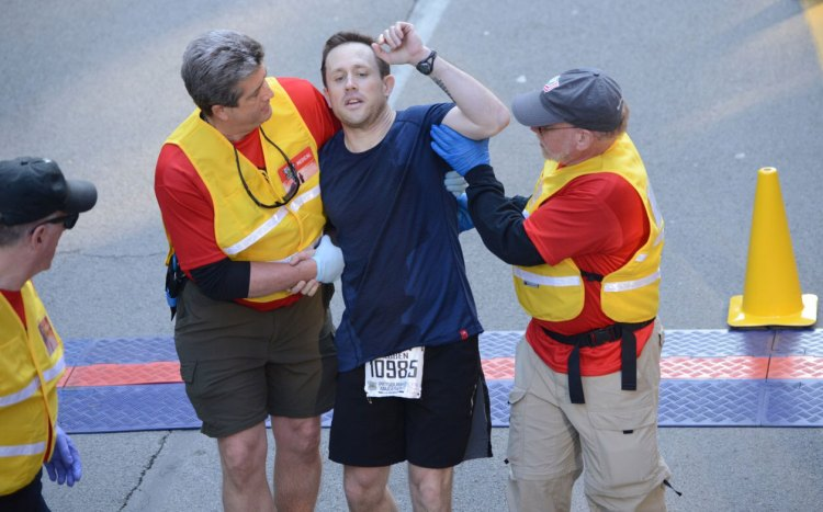 Runner in distress at the end of the race.  (Bob Donaldson/Post-Gazette)