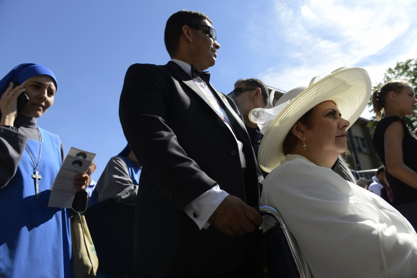 Carlos Matos-Ramos Jr. and his mother Lourdes wait in the security line to get to the Basilica. Mrs. Matos-Ramos has a chronic blood condition and she hopes to be blessed by Pope Francis. Pope Francis canonizes Junipero Serra during a Mass at the Basilica of the National Shrine of the Immaculate Conception in Washington, D.C., on Wednesday, Sept. 23, 2015.