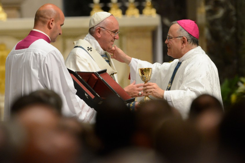 Pope Francis presents a chalice to Cardinal Charles Chaput, archbishop of Philadelphia, as the Pope celebrates Mass at the Cathedral Basilica of Saints Peter and Paul in Philadelphia on Saturday. The Mass was primarily for clergy, religious sisters and lay leaders from the archdiocese of Philadelphia. Cardinal Chaput said he would call the city Francisville on this day if he could.