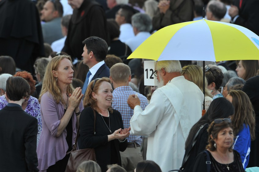 Women receive communion during the canonization Mass for Junipero Serra at the Basilica of the National Shrine of the Immaculate Conception on Wednesday.