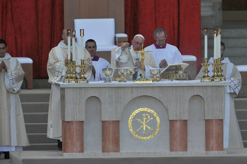 Pope Francis prepares the gifts during the liturgy of the Eucharist during the canonization Mass for Junipero Serra at the Basilica of the National Shrine of the Immaculate Conception on Wednesday.